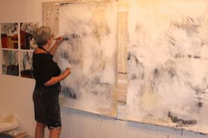 Brucie Holler, Artist, works in her studio.