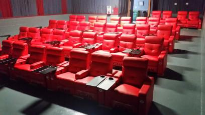 Rows of red chairs in theater