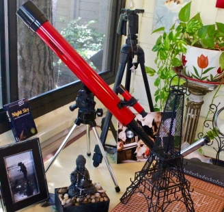 telescope and tripod on card table